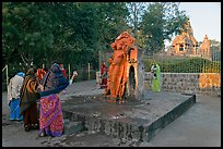 Women throwing water at  Shiva image. Khajuraho, Madhya Pradesh, India