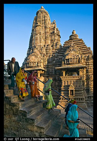 Worshipers going down stairs in front of Lakshmana temple. Khajuraho, Madhya Pradesh, India
