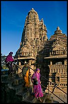 Women going down stairs in front of Lakshmana temple. Khajuraho, Madhya Pradesh, India (color)