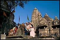 Worshippers making offering at Matangesvara temple with  Lakshmana behind. Khajuraho, Madhya Pradesh, India