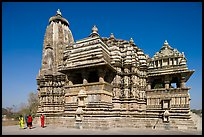 Devi Jagadamba temple with women walking. Khajuraho, Madhya Pradesh, India
