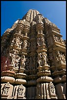 Sculptures and sikhara of Devi Jagadamba temple from below. Khajuraho, Madhya Pradesh, India
