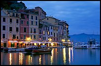 Houses reflected in harbor at dusk, Portofino. Liguria, Italy