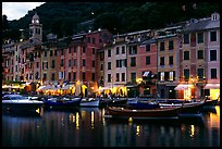Pastes-colored houses around harbor at dusk, Portofino. Liguria, Italy