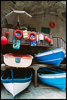Tiny fishing boats stacked in the main square, Riomaggiore. Cinque Terre, Liguria, Italy (color)