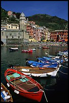 Colorful samll fishing boats in the harbor and main plaza, Vernazza. Cinque Terre, Liguria, Italy