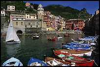 Colorful fishing boats in the harbor and Piazza Guglielmo Marconi, Vernazza. Cinque Terre, Liguria, Italy (color)