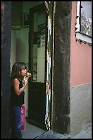 Girl enjoying gelato (ice-cream), Vernazza. Cinque Terre, Liguria, Italy (color)