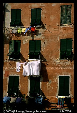Typical terra cotta facade with hanging laundry and green shutters, Vernazza. Cinque Terre, Liguria, Italy (color)