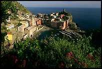 Harbor, church, 11th century castle and village, late afternoon, Vernazza. Cinque Terre, Liguria, Italy
