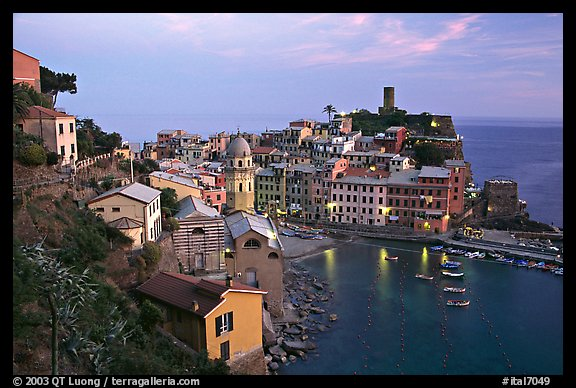 Harbor, church, medieval castle and village, sunset, Vernazza. Cinque Terre, Liguria, Italy
