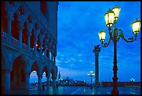 Lamp, column with Lion, Piazza San Marco (Square Saint Mark) at dawn. Venice, Veneto, Italy (color)