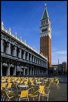 Campanile, Zecca, and empty chairs, Piazza San Marco (Square Saint Mark), early morning. Venice, Veneto, Italy