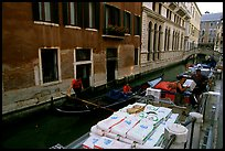 Delivery through a little canal. Venice, Veneto, Italy (color)
