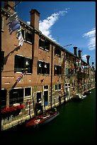 Resident stepping from his doorway to his boat,  Castello. Venice, Veneto, Italy