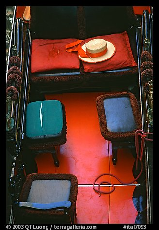 Empty gondola with seats and gondolier's hat. Venice, Veneto, Italy
