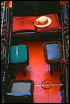 Empty gondola with seats and gondolier's hat. Venice, Veneto, Italy (color)