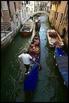 Gondolas lined up in narrow canal. Venice, Veneto, Italy