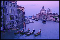 Gondolas, Grand Canal, Santa Maria della Salute church from the Academy Bridge,  sunset. Venice, Veneto, Italy
