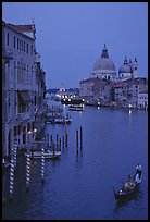 Gondola, Grand Canal, Santa Maria della Salute church from the Academy Bridge, dusk. Venice, Veneto, Italy