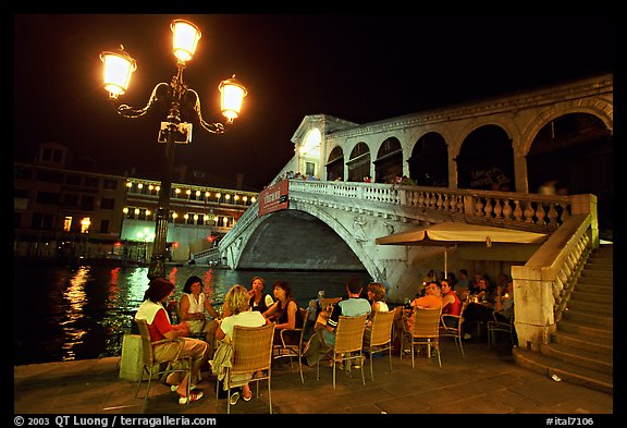 Outdoor cafe terrace,  Rialto Bridge at night. Venice, Veneto, Italy (color)