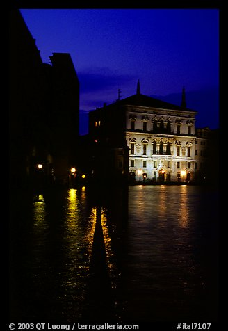 Rezzonico palace illuminated at night, along the Grand Canal. Venice, Veneto, Italy