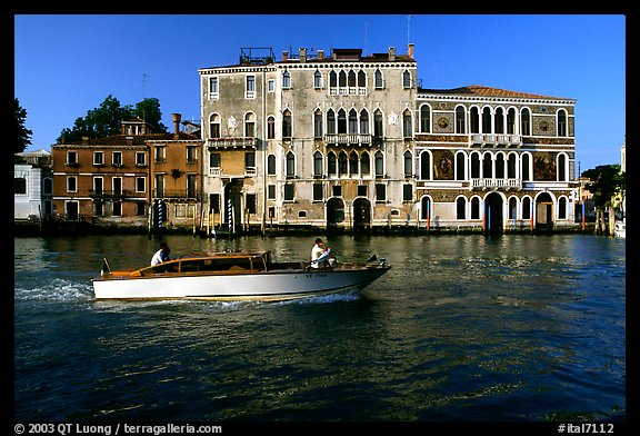 Water taxi passes in front of the Palazzo Dorio on the Grand Canal. Venice, Veneto, Italy