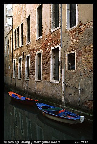 Small boats moored along a wall in a small side canal. Venice, Veneto, Italy (color)