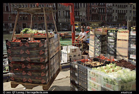Delivery of fresh produce from the Grand Canal. Venice, Veneto, Italy (color)