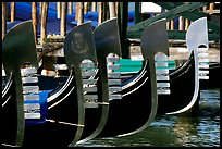 Row of gondolas prows, with their characteristic ferri. Venice, Veneto, Italy