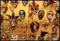 Carnival masks over golden background, Burano. Venice, Veneto, Italy