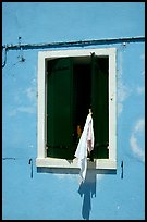 Laundry hanging from a window, Burano. Venice, Veneto, Italy (color)
