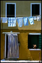 Hanging laundry and colored wall, Burano. Venice, Veneto, Italy (color)