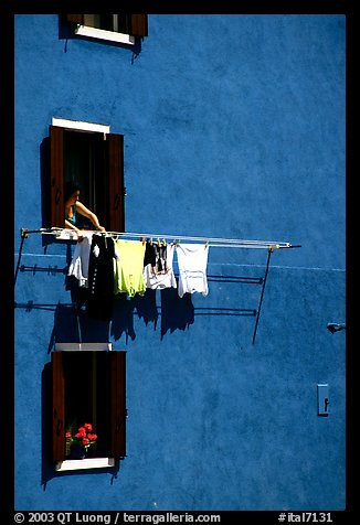 Windows, hanging laundry, blue house, Burano. Venice, Veneto, Italy (color)