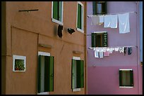 Multicolored houses and hanging laundry, Burano. Venice, Veneto, Italy ( color)
