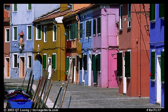 Sidewalk and row of brightly painted houses, Burano. Venice, Veneto, Italy (color)