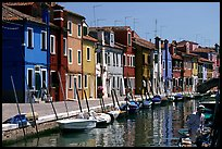 Canal lined with typical brightly painted houses, Burano. Venice, Veneto, Italy (color)