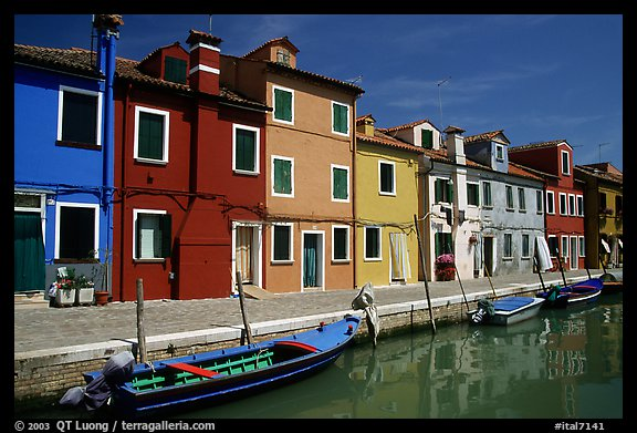 Canal bordered by colorfully painted houses, Burano. Venice, Veneto, Italy (color)