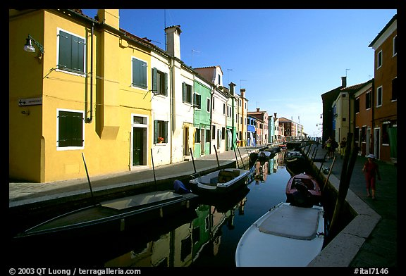 Colorful painted houses along canal, Burano. Venice, Veneto, Italy (color)