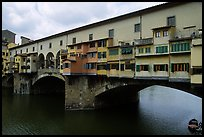 Ponte Vecchio (1345),  old bridge lined with shops. Florence, Tuscany, Italy (color)