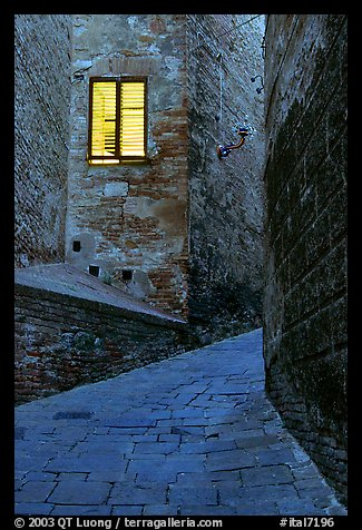 Street and window at dawn. Siena, Tuscany, Italy