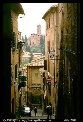 Narrow street with church in background. Siena, Tuscany, Italy (color)