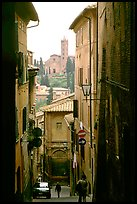 Narrow street with church in background. Siena, Tuscany, Italy
