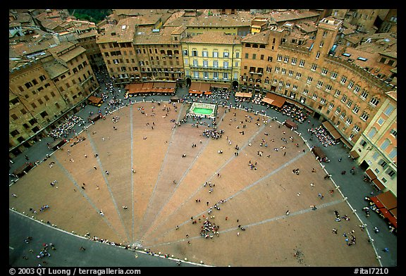 Medieval Piazza Del Campo with paving divided into nine sectors to represent Council of Nine.. Siena, Tuscany, Italy (color)