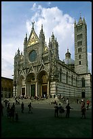 Richly decorated cathedral facade, afternoon. Siena, Tuscany, Italy (color)