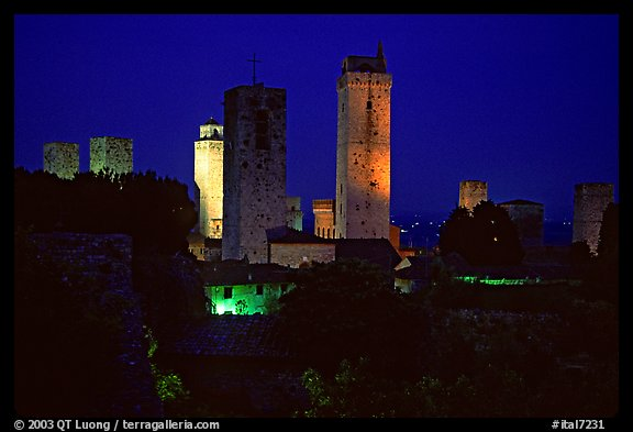 Medieval towers seen from the Rocca at night. San Gimignano, Tuscany, Italy