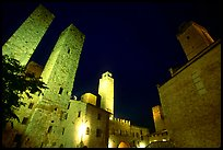 Medieval towers above Piazza del Duomo at night. San Gimignano, Tuscany, Italy