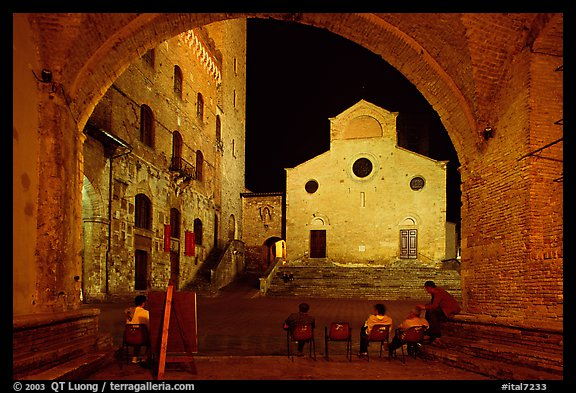 Duomo framed by an arch at night. San Gimignano, Tuscany, Italy (color)