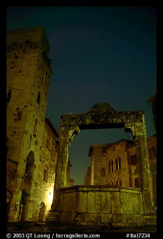 Well on Piazza della Cisterna at night. San Gimignano, Tuscany, Italy (color)