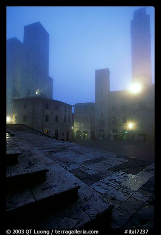 Piazza del Duomo at dawn in the fog. San Gimignano, Tuscany, Italy